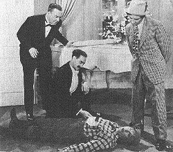 Donald MacBride, Groucho, Harpo, and Chico in a scene from the film.
